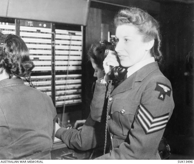 England. C. 1944-12. Sergeant Tessa Best, supervisor on duty in a station telephone exchange. She has been in the WAAF for five years, and was born in Australia.