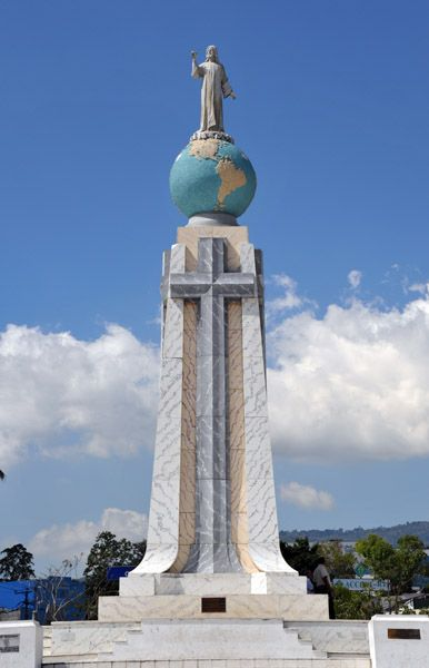 Monumento al Divino Salvador del Mundo (English: Monument to the Divine Savior of the World) is a monument located on Plaza El Salvador del Mundo (The Savior of the World Plaza) in San Salvador City, El Salvador. It consists of a statue of Jesus Christ standing a global sphere of planet earth, placed on top of the tall four-sided concrete base pedestal. It is a landmark located in the country's capital San Salvador.