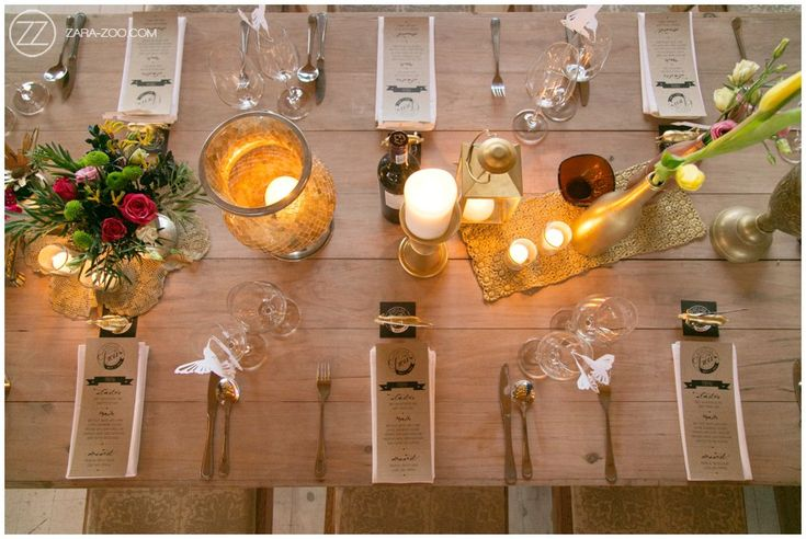 Wedding Reception, table decor. Vibrant pink and gold elements. Raw wood, gold sprayed vases.