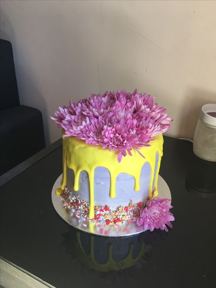 Drip cake with fresh flowers and sprinkles