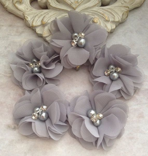 This lot of five chiffon flowers is perfect for all your DIY needs. A beautiful grey colored chiffon is adorned with rhinestones and pearls. These