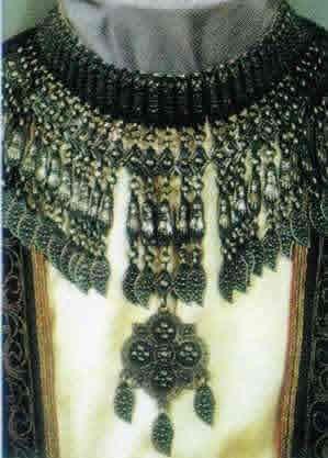 An Armenian choker necklace (kirdan), with a cross-shaped pendent.  Eastern Anatolia, late-Ottoman era, ca. 1900.