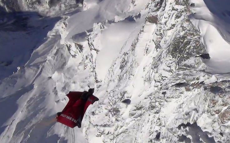 Daredevil Dan Vicary leaps from a helicopter and glides three miles down a   Swiss mountain using only a nylon wingsuit