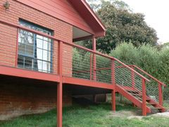 Stainless balustrade for timber post