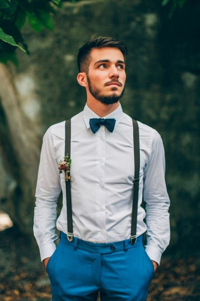 c7414be28996f suspenders with a boutonniere, worn with a blue shirt, and teal blue  trousers, mens wedding guest attire, on young man with a bowtie