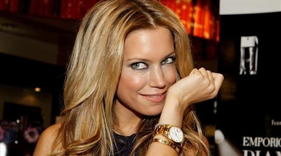 Sylvie van der Vaart wears a Gold Rolex Day-Date Watch