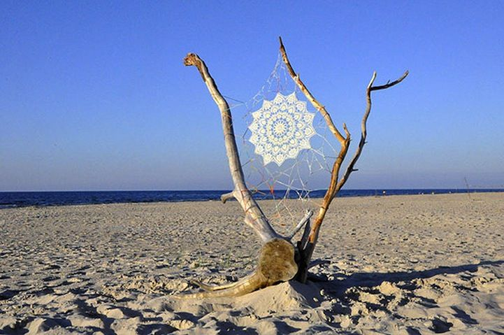 lace installations along the Baltic Sea byNeSpoon