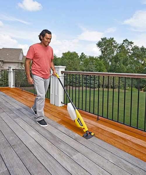 Deck maintenance goes faster when you don't pause to reload a roller. Squeezing the Renuvo's handle-mounted trigger feeds stain from a removable half-gallon reservoir to a nylon pad and an integral groove brush, so the deck-board faces and edges are coated at the same time. | Renuvo deck-staining tool, by @wagnerspraytech