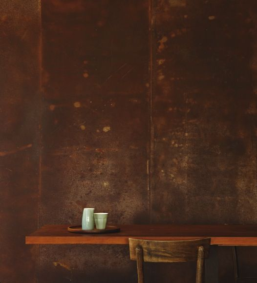 Architect Sean Godsell has used a wall of rusted steel, with a rich patina, at the eastern end of the living space.