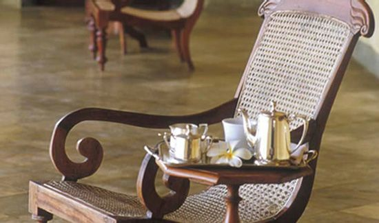 High tea on the veranda. Love the colonial easy chair!