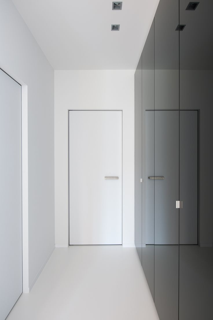 white interior doors on a white floor with a black closet