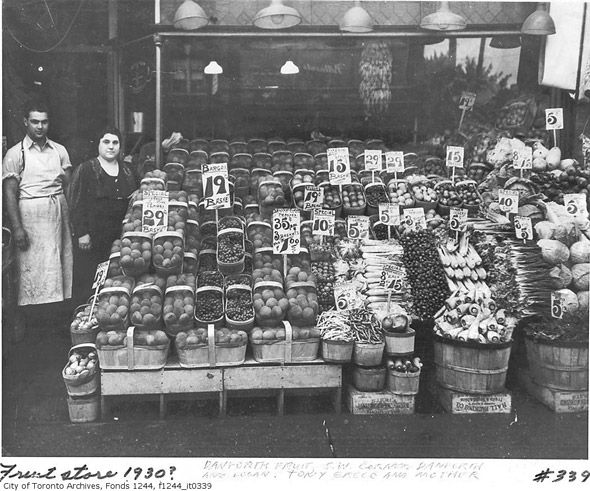 A fresh produce display in front of a Danforth grocery store, Toronto, Canada, c. #1930's. #vintage #supermarket #shopping