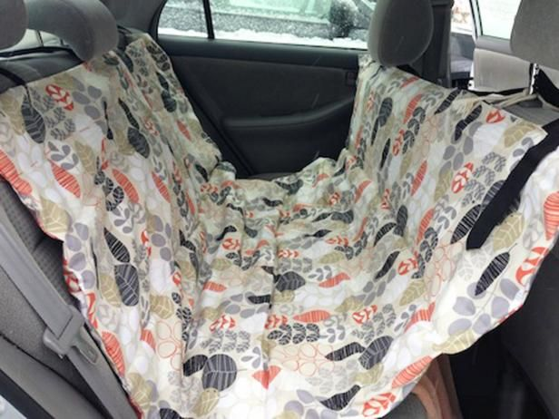 Learn How to Make a DIY Pet Car Hammock | this is a really good set of instructions - clear pictures and simple written guide to make this great seat cover for your car. I'd need to work out where to put the opening so that I could attach the seat belts but I'm sure that is pretty straight forward.