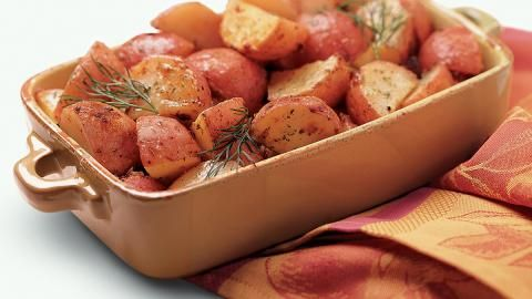 Ranch Roasted Potatoes...the easiest recipe ever and an extremely tasty side dish. Red potatoes, veg, oil, and a packet of Hidden Valley Ranch in a gallon-sized bag.....shake and bake those babies!