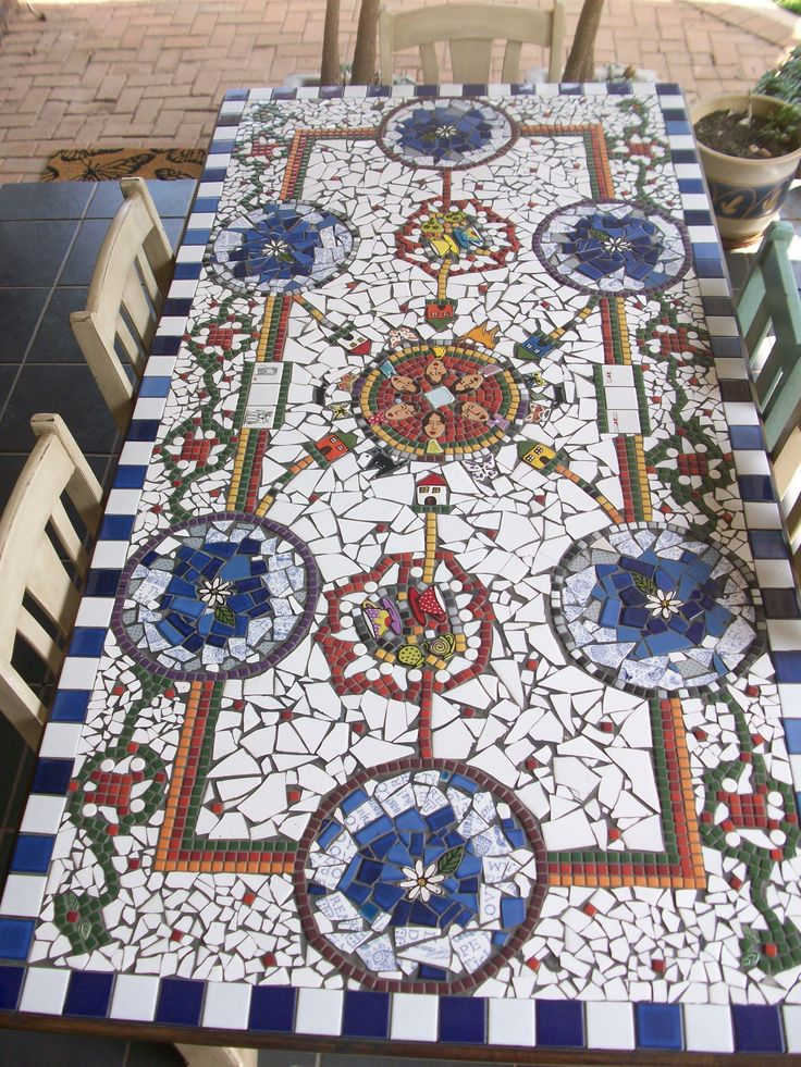 Breakfast table mosaic top, beautiful and no need for a table cloth.