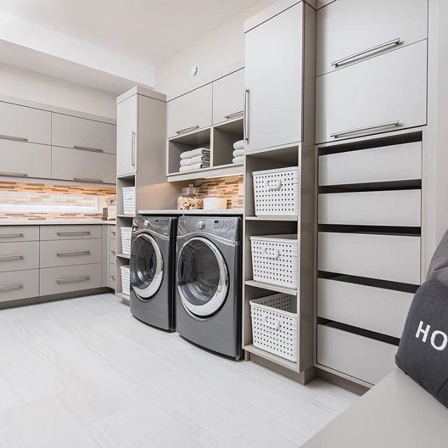 Make #laundry seem like less of a chore in this organized and functional space. Hawksview Homes