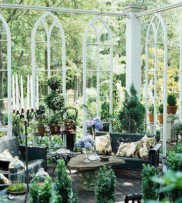 A friend has been to this woman's (a garden designer) home on a garden tour in Georgia. This spectacular garden room features gothic windows that were part of an old church.