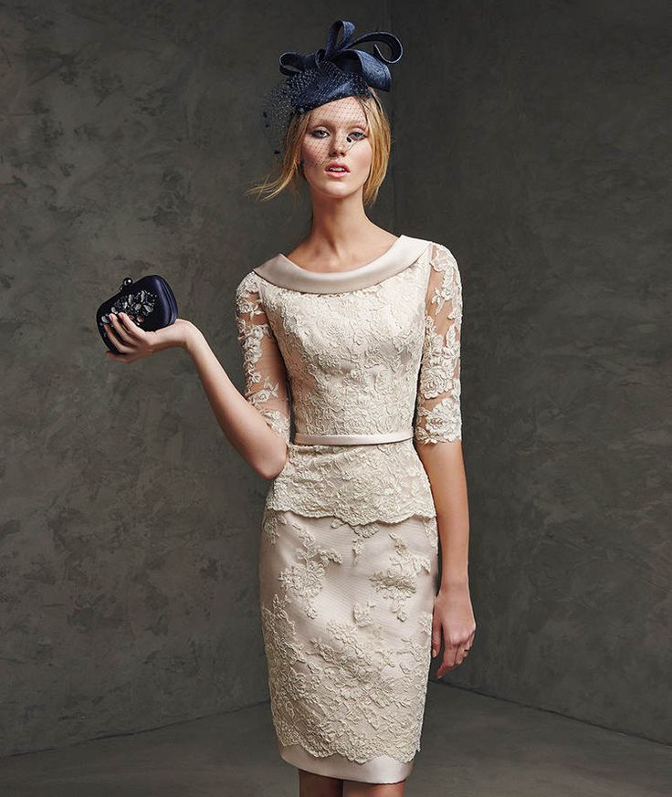 LAIN- Pronovias Cocktail 2016. Mikado silk and lace dress. Lace bodice with bateau neckline at the front and V-neckline at the back decorated with mikado silk edging. Narrow mikado silk belt at the waist and elbow-length tulle sleeves with lace appliqués.