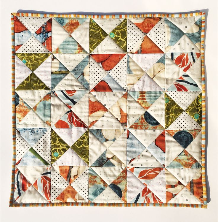 Quarter square triangles pillow / cushion. Laura Gunn fabric. Low ratio fabric. Hourglass, patchwork and quilting.
