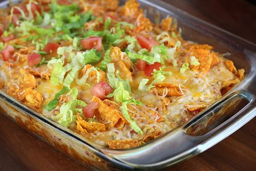 DORITO CHICKEN CASSEROLE  preheat oven 350. mix 2c shredded chicken, 2c shredded cheese, can of cream of chicken, 1/2c milk, 1/2c sour cream, can of drained rotel, & 1/2 pack taco seasoning. Grease casserole dish. Crush 1/2 bag doritos and place in bottom, top with mixture, crush a few doritos on top. Bake for 30 minutes. Garnish with shredded lettuce & diced tomato.