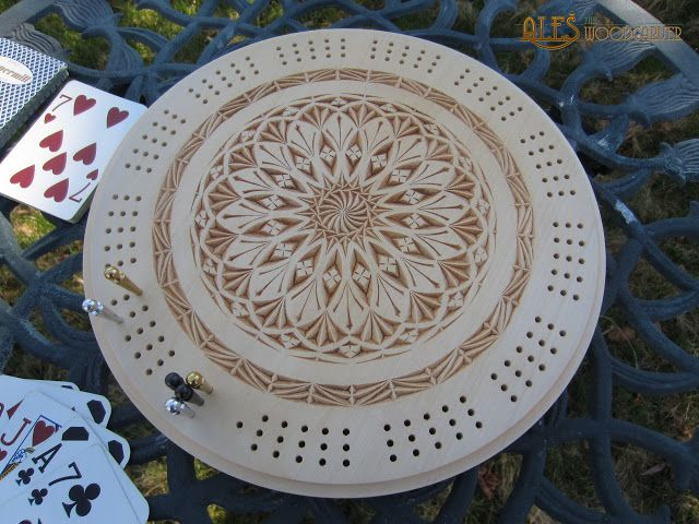 11'' round cribbage board, chip carving by Ales Janosik. The design was sketched on the blank wood and hand carved.