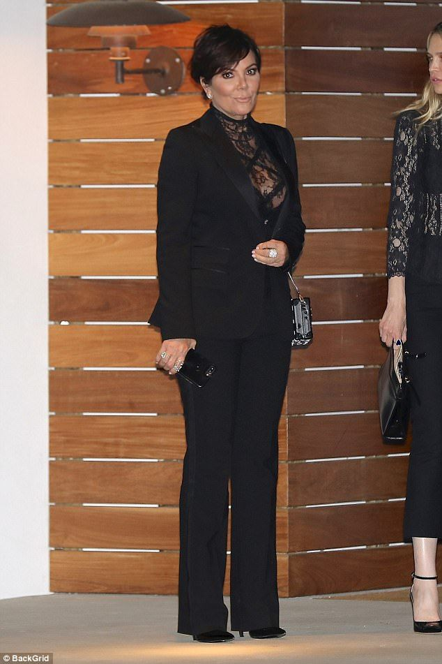 Impressive:The star looked sexy in a black lace top with a tuxedo suit. Her hair was brus...