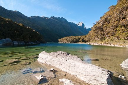 Routeburn Track One of New Zealand's Nine Great Walks. Each year a girlfriend and I plan a 'No-men holiday' which usually includes a hike or two andlots of wine tastings in between. A couple of years back we decided tohike both the Milford and the Routeburn Tracks in the South Island, two of New Zealand's Great walks.