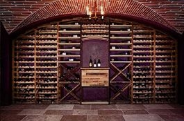 Custom Wine Cellars by Vintage Cellars | Underground Wine Cellar Design - The centerpiece of this spectacular brick wine cellar is its sustainable wine racking made from reclaimed wine barrels & fermentation tanks.  http://www.vintagecellars.com/wine-cellar-design/underground-wine-cellar