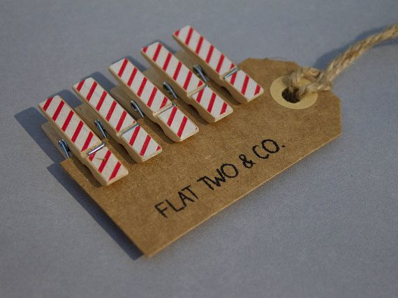 Pack of 6 candy cane striped decorative wooden pegs. Most suitable for indoor use however could be used outside on a nice day. These medium sized pegs work best to hold papers together, hang photos or artwork or even act as wedding favours/place card holders. The specifics: • each peg measures to wide: 7mm and length: 35mm • decorations are applied with paper tape • each order includes 6 of the same design peg – if you would like a variety pack please get in touch!   Delivery: • pegs are...