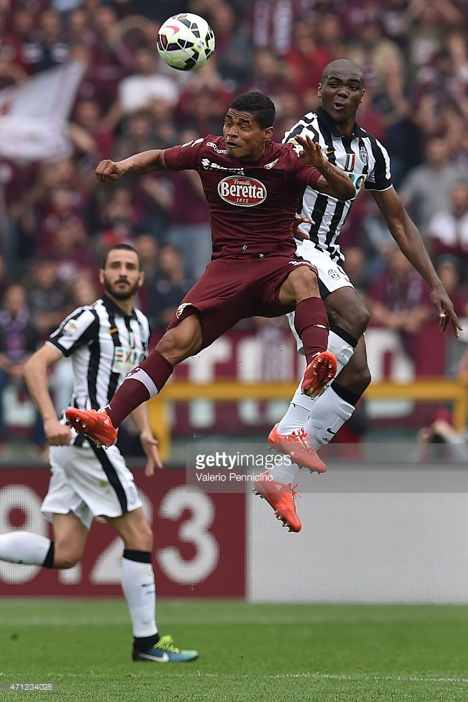 Josef Alexander Martinez (L) of Torino FC goes up with Angelo Ogbonna of Juventus FC during the Serie A match between Torino FC and Juventus FC at Stadio Olimpico di Torino on April 26, 2015 in Turin, Italy.