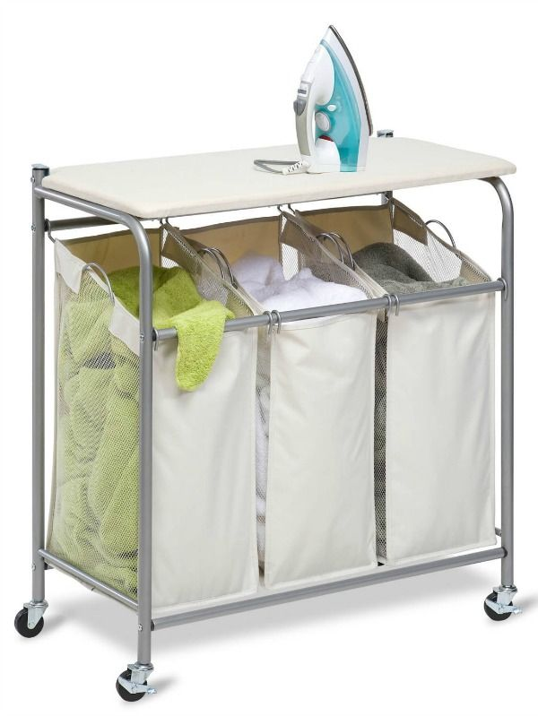 Combine two laundry tasks into one storage unit when you get a laundry sorter with an attached ironing board on top {featured on Home Storage Solutions 101}