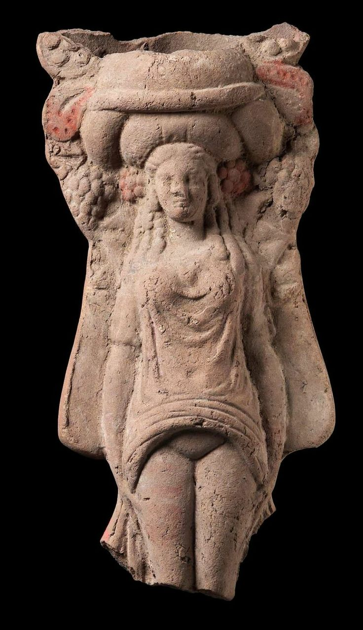 """Figurine of Isis-Aphrodite anasyr(o)mene (""""revealing the womb"""").Greek, East Greek,Hellenistic Period,3rd–2nd century B.C.In Hellenistic and Roman times,Aphrodite's identity was often fused with those of Egyptian fertility goddesses:Isis, Hathor and Bubastis.This figurine represents Isis-Aphrodite anasyromene or Isis-Bubastis.She lifts her short-sleeved tunic to reveal pubic area and wears elaborate kalathos-shaped headdress,reminiscent of those worn by Cypriot Aphrodite."""