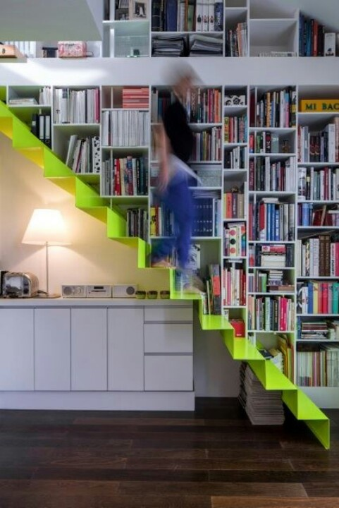 simple folded steel stair next to bookcase