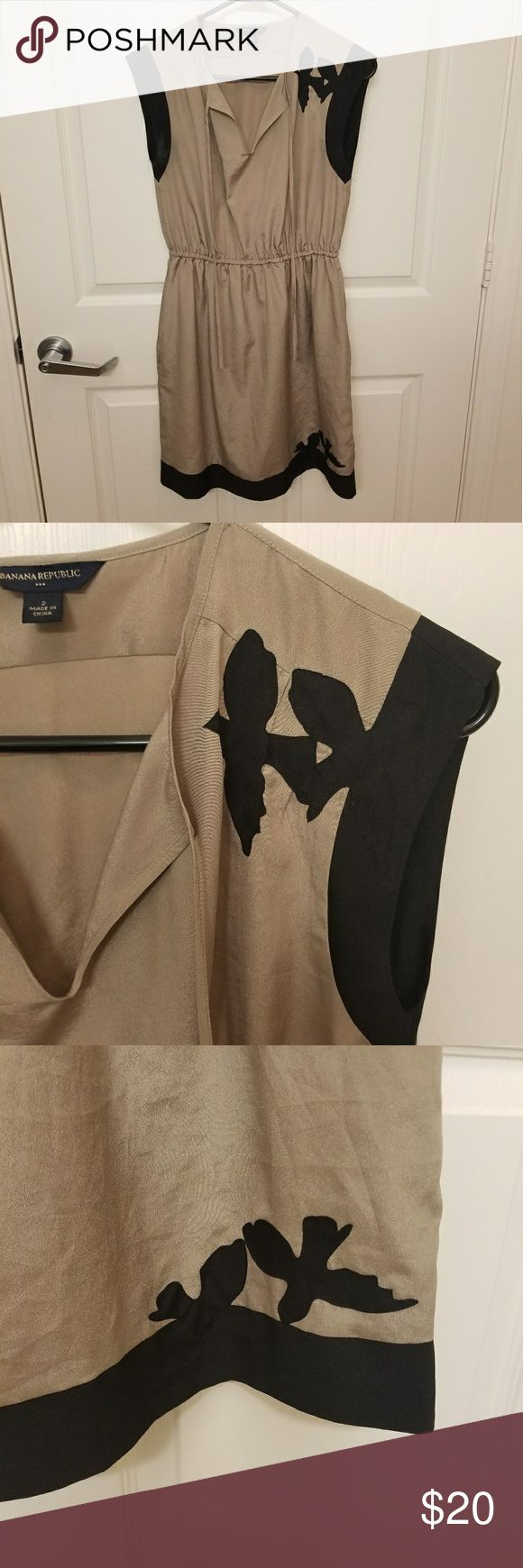 Banana Republic dress with bird detail Taupe and black banana republic dress with bird detail on shoulder and hemline. Cinged waist is elastic. Very light and comfy. Looks great with leggings and boots! Banana Republic Dresses Midi