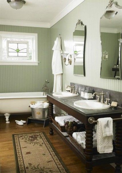 <3 Claw foot tub and double sinks on what looks like an old buffet/serving table.  <3