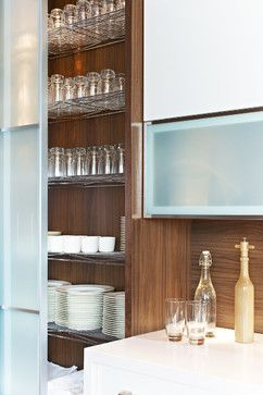 All mill-work designed, provided and installed by Yorkville Design Centre Featuring 250cm tall sliding glass doors with wire shelves for storage.