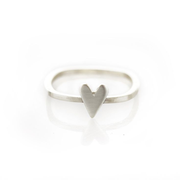 love it   Thin square shaped sterling silver ring with silver heart.  Please check our info page for more details on ring sizes.