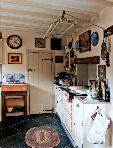A modified butchers block and blue delft tiles in the kitchen make perfect country decorating english cottage