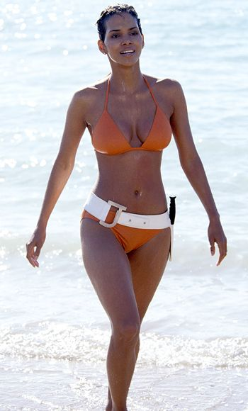 "For 2002's Die Another Day, Halle Berry paid homage to the first Bond girl, Ursula Andress. She made her entrance in an unforgettable orange-red bikini, complete with a knife belt, ""and killed,"" Rubenstein said, ""both literally and figuratively."""