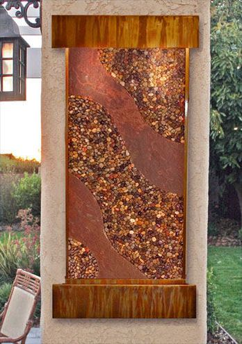 Wall Fountain by Kinetic Fountains - the Aspen Falls' water wonders  Indoor Waterfalls | Jan-15-07 The Aspen Falls wall fountain can add serenity to your home – both inside and out!! This versatile pebbles wall fountain by Kinetic Fountains produces a soothing sound as... more »   I