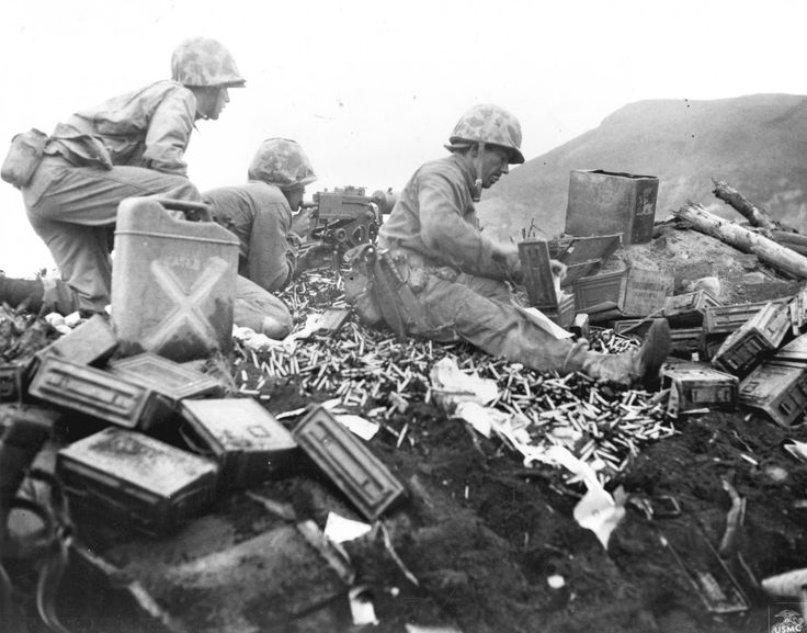 Iwo Jima was prime real estate for Americans to launch air raids against Japan, but the island was heavily guarded by Japanese forces. Amphibious Marines are seen here battling at the foot of Mount Suribachi.