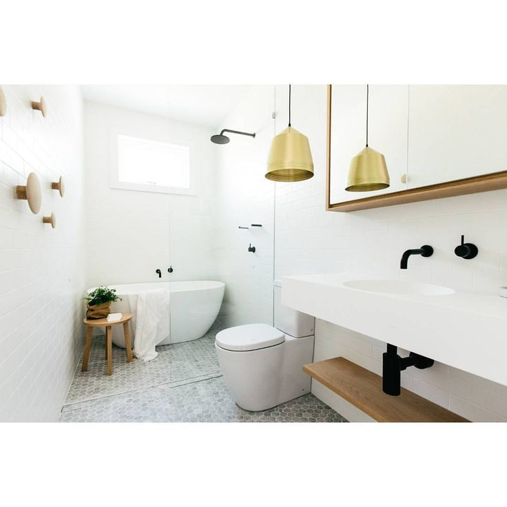 """Reece Bathrooms on Instagram: """"A favourite of ours from CM Studio Architecture. The Scandinavian-inspired bathroom has continued its popularity due to its minimal and fresh look. Timber used sparingly is very effective as well as other materials such as solid surface (Omvivo Neo basin) and stone composite (Clearwater Formoso bath). Despite the very pure aesthetic, warmth is achieved through the use of these materials."""""""