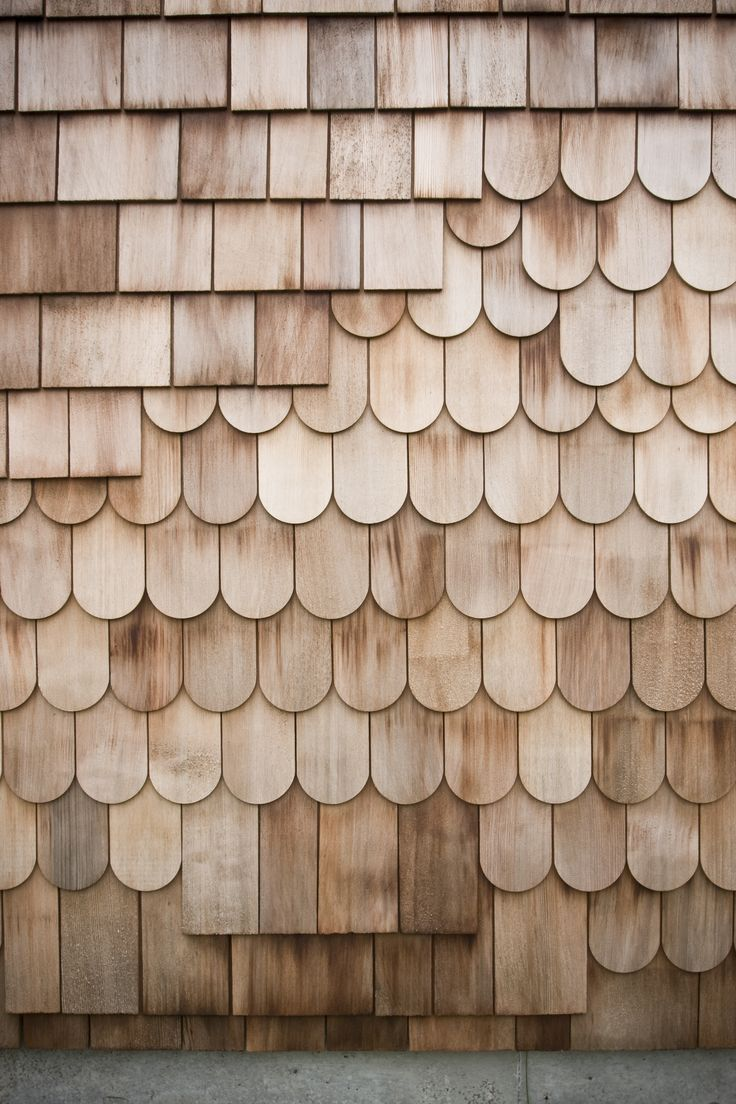 A mix of red cedar shingles and scales make of the exterior. The design is intended to be a