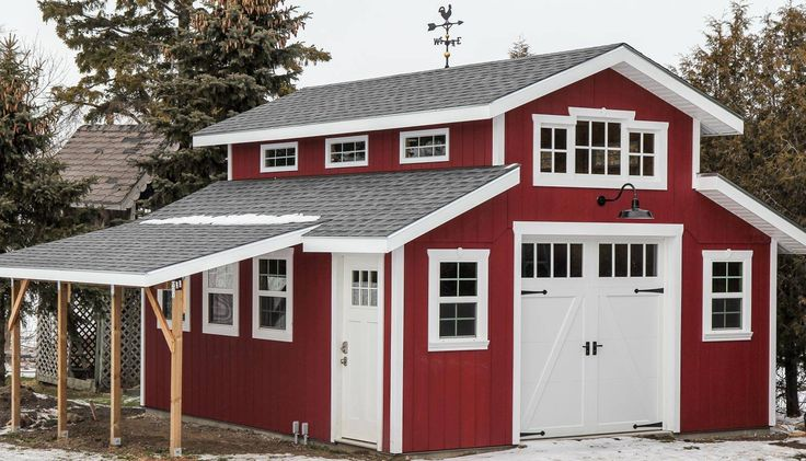 Charming red barn garage featuring clopay coachman for Carriage house barn