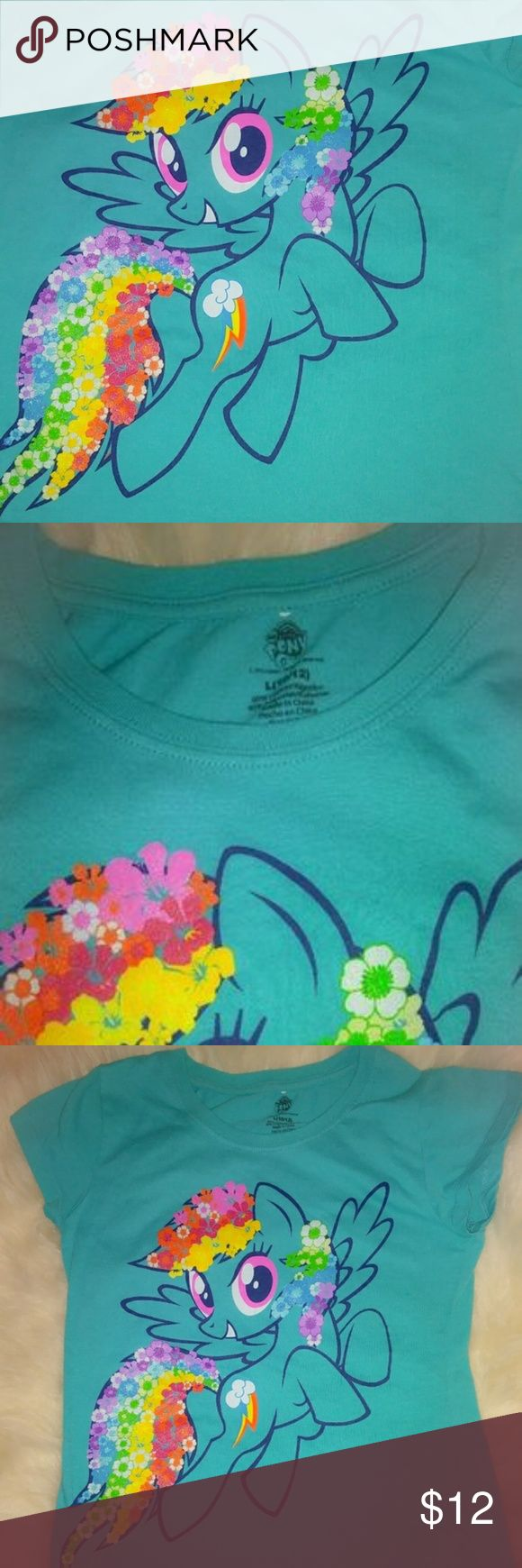 My Little Pony Rain Bow Dash Size 10/12 Perfect my little pony shirt! Worn one time than left at Nanas and once found didnt fit anymore. Size 10/12 No rips holes or stains My Little Pony Shirts & Tops