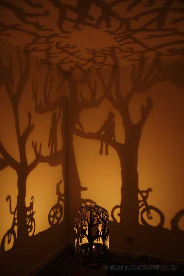 """Beautiful hand-plasma cut metal work made from an old gas bottle. The shadows are projected from a single tea light candle. """"we sat in the trees and watched it for hours"""" by dan rawlings www.danrawlings.wordpress.com #recycledart, #cutmetal #shadowart"""