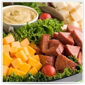 Nibblers Delight:  Bite-sized cubes of Black Creek cheddar and other cheeses, along with summer sausage, hard salami and pepperoni create a hearty mealtime tray with spicy mustard dip.