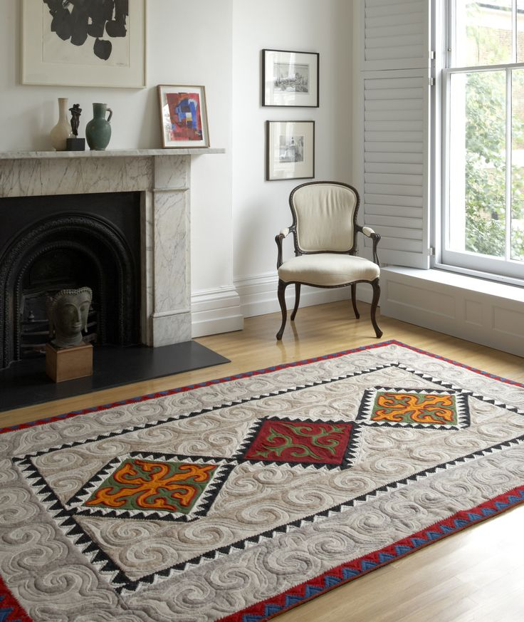 Large Shyrdak Felt rug with a bright diamond pattern set against a neutral background feltrugs.co.uk