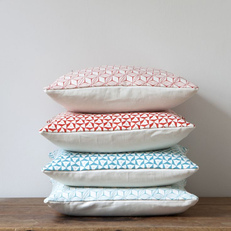 These cushions are silkscreen printed by hand with a tumbling pattern in Katy Goutefangea's East London studio.