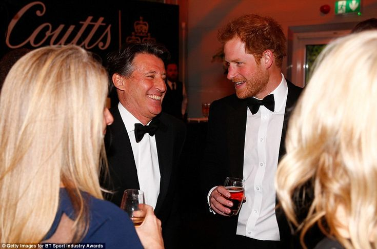 Prince Harry shares a joke with Sebastian Coe, British Olympian and President of the International Association of Athletics Federations